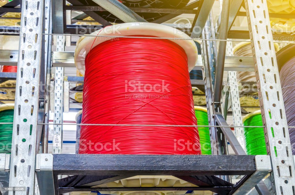 Large Coils With Colored Electrical Wires On Huge Shelves In ... on