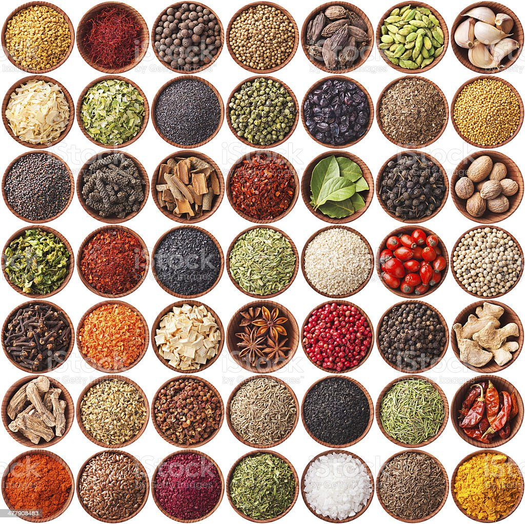large collection of different spices and herbs stock photo