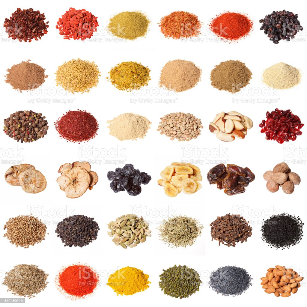 Large collection of different spices, herbs, nuts, dried fruits stock photo
