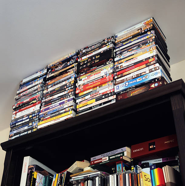 Large collection of DVDs on a domestic bookcase stock photo