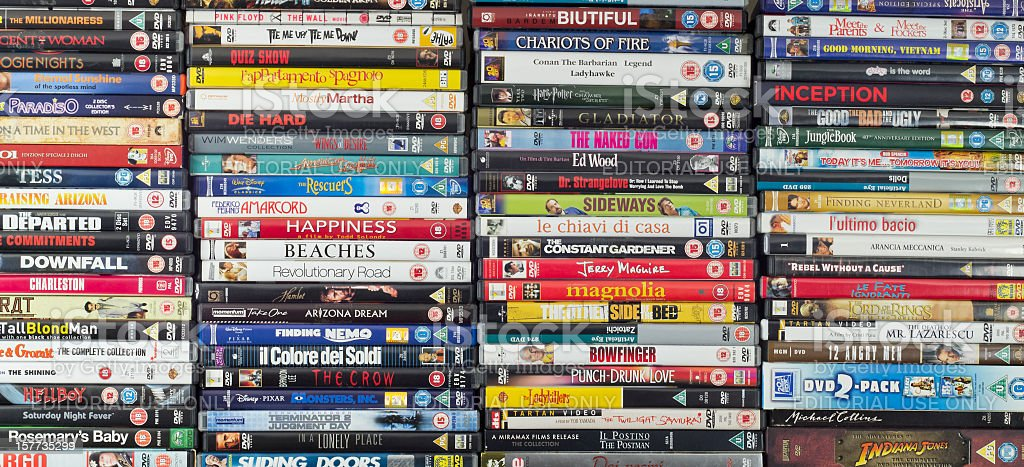 Large collection of movie DVDs, stacked stock photo