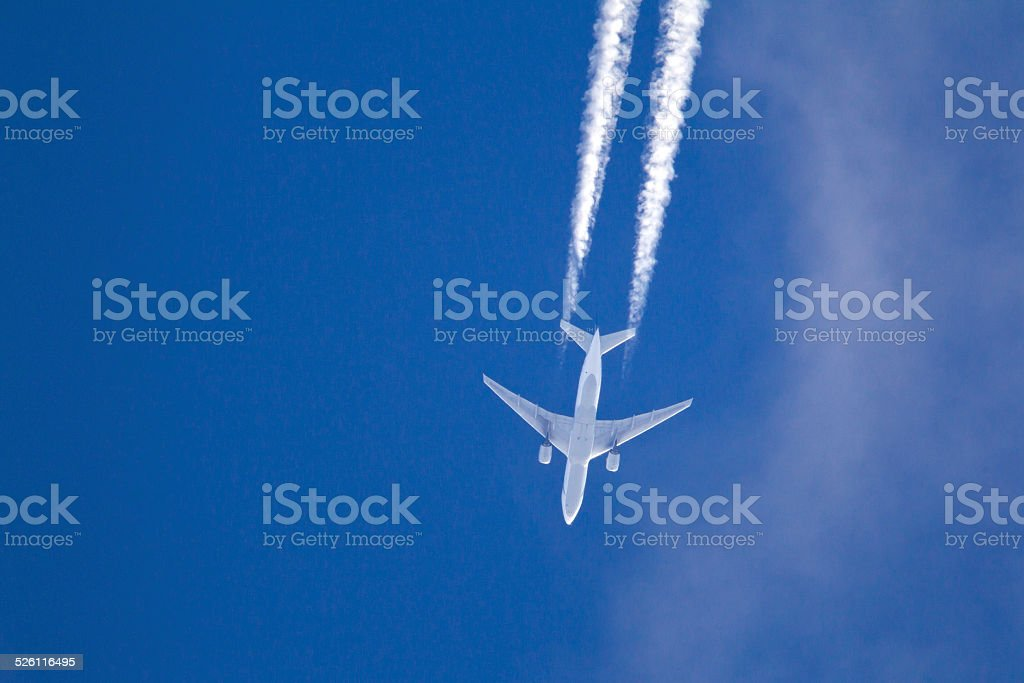 Large commercial aircraft at high altitude stock photo