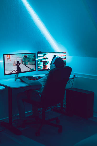 Large computer gaming setup lets child play esport video games on two screens stock photo