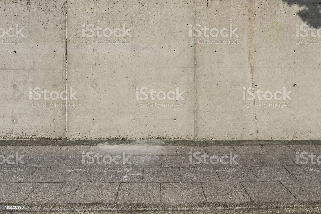 Large concrete wall with sideway in front royalty-free stock photo