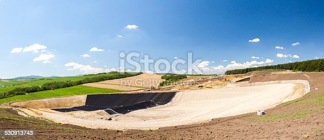 Construction of a large garbage dump site surrounded by green nature