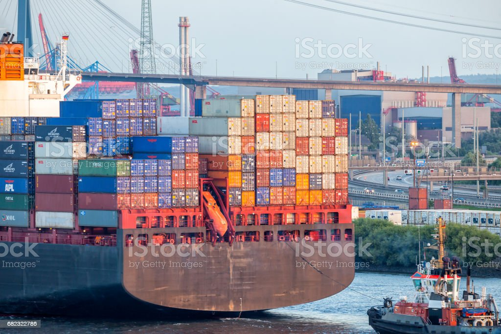 Large Container Ship Assisted By Tugboat in Hamburg Harbour, Germany stock photo