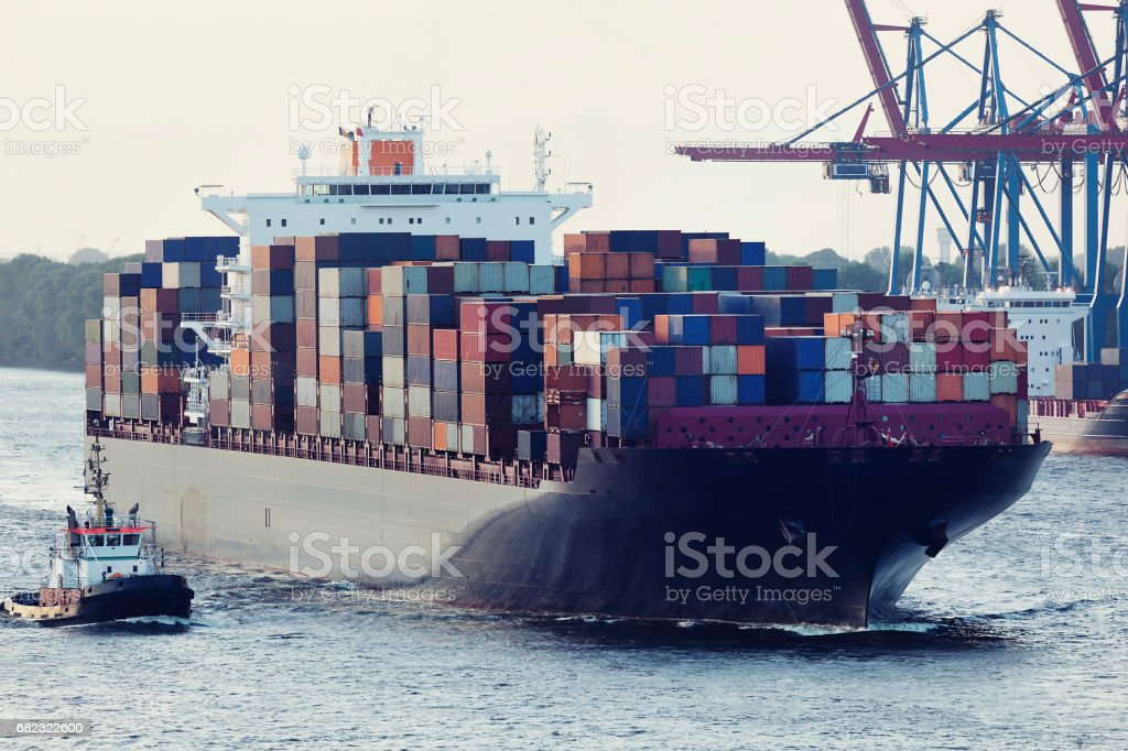Large Container Ship Assisted By Tugboat in Hamburg Harbour stock photo