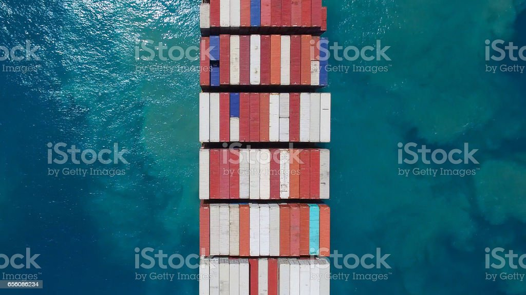Large container ship at sea - Aerial image stock photo