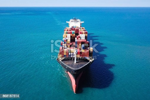 istock Large container ship at sea - Top down Aerial Image 868187514