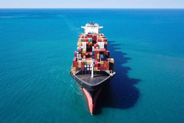 Large container ship at sea - Top down Aerial Image stock photo