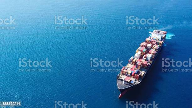Photo of Large container ship at sea - Top down Aerial Image