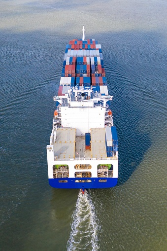 483418977 istock photo Large container ship entering / leaving port. 1180419214
