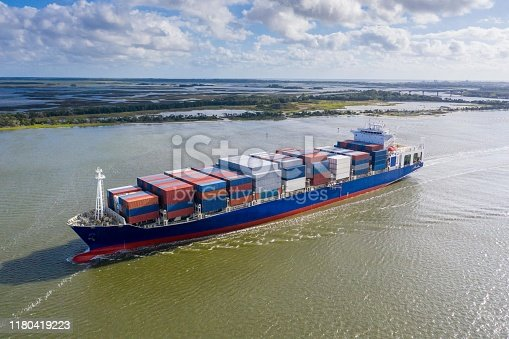 483418977istockphoto Large container ship entering / leaving port. 1180419223