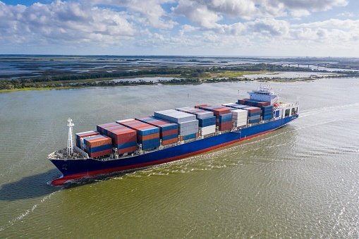 483418977 istock photo Large container ship entering / leaving port. 1180419223