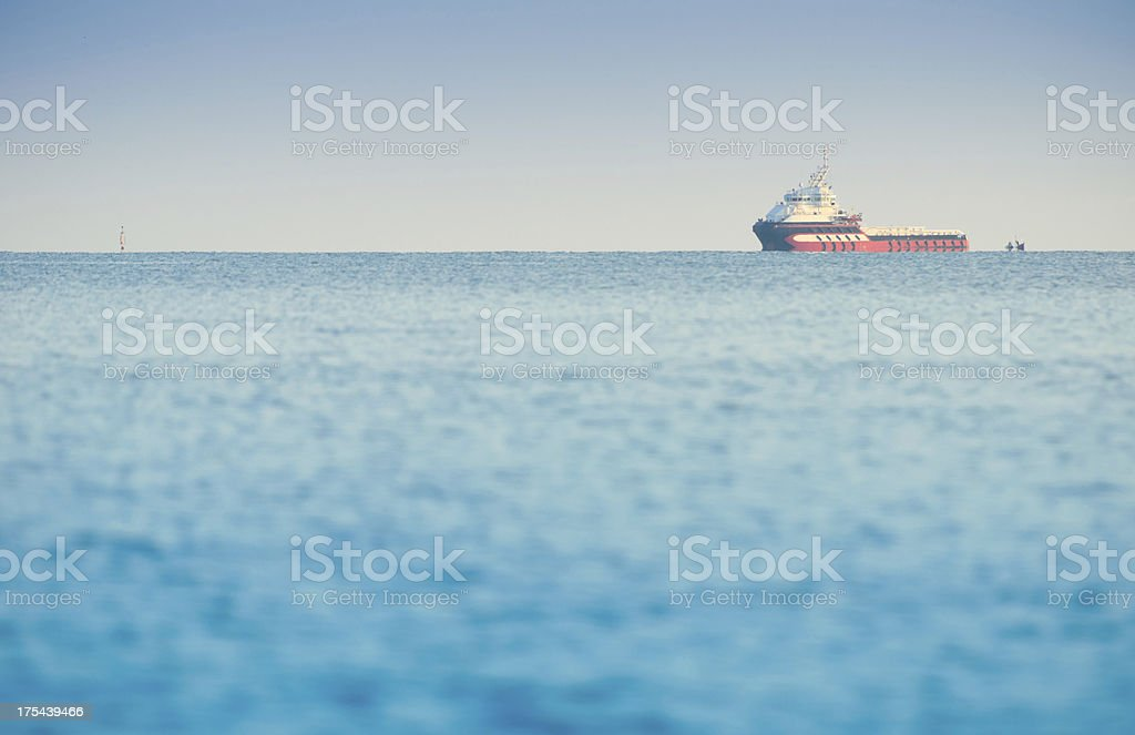 Large container ship in deep blue ocean royalty-free stock photo