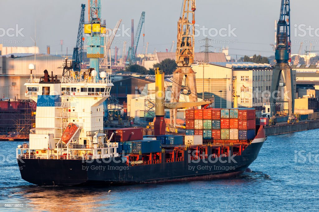 Large Container Ship in Hamburg Harbour at Sunset, Germany stock photo