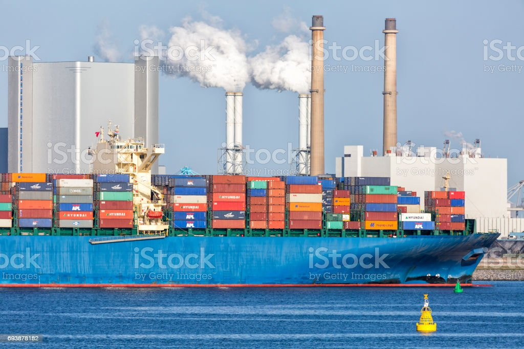 Large Container Ship Leaving Port of Rotterdam, Netherlands stock photo