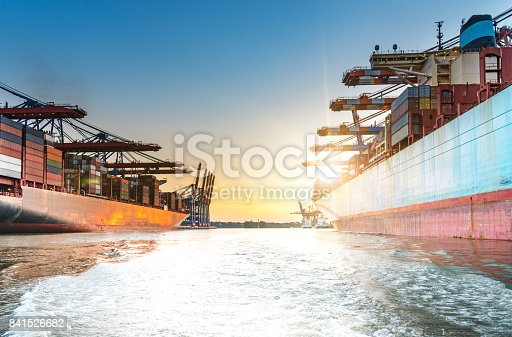 637816284istockphoto large container ships in harbor at sunset 841526682