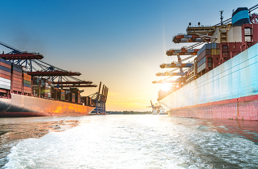 637816284 istock photo large container ships in harbor at sunset 841526682
