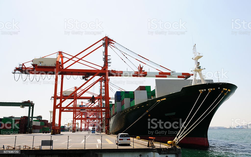 Large container vessel loading in Port of Tokyo Bay stock photo