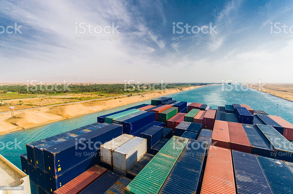 large container vessel ship passing suez canal stock photo