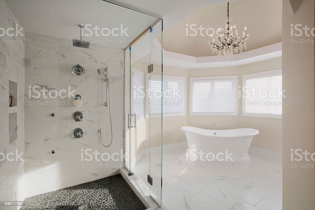 Large contemporary master bathroom in residential home stock photo