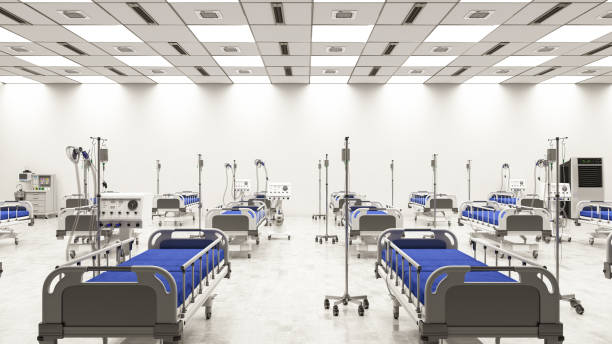 stor coronavirus pandemic hospital ward med tomma sängar i stora lager - temporär bildbanksfoton och bilder