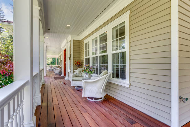 Large country home with wrap-around deck. stock photo