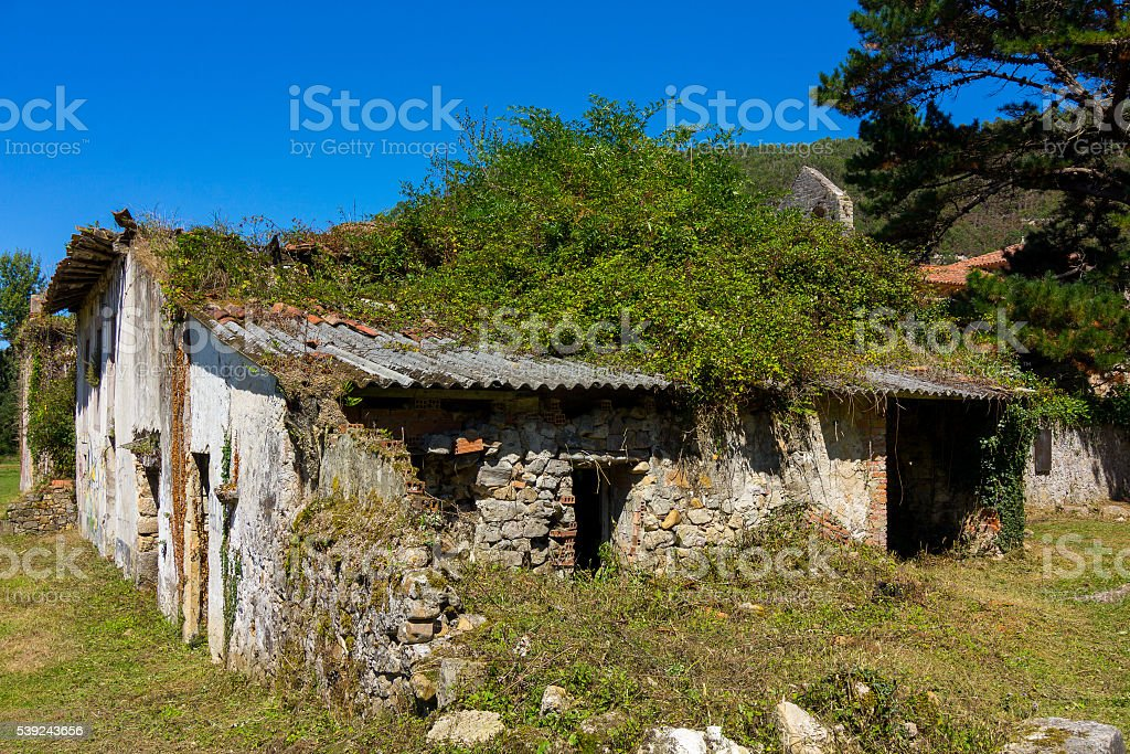 large country house abandoned in ruins with vegetation royalty-free stock photo