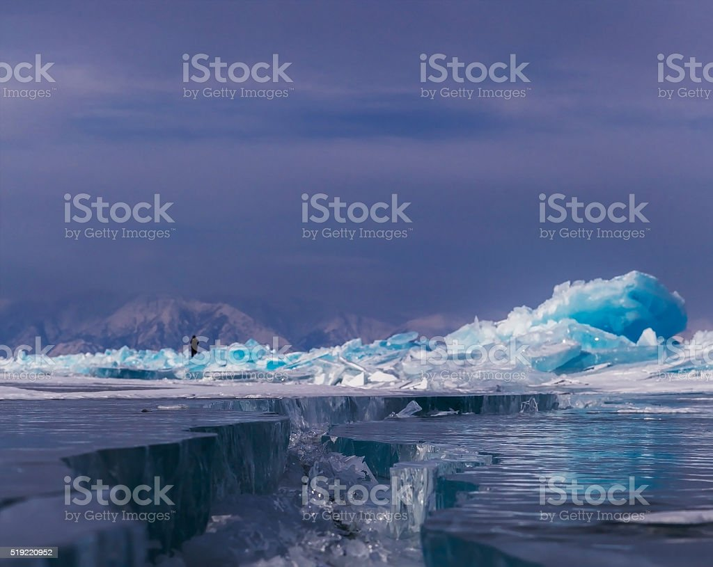 Large cracks on surface of the ice stock photo