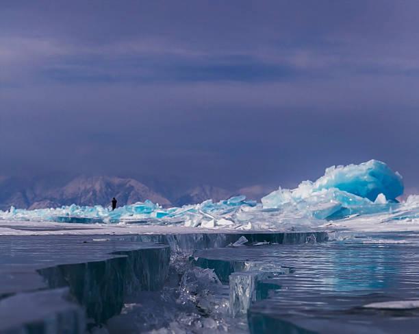 Large cracks on surface of the ice stock photo