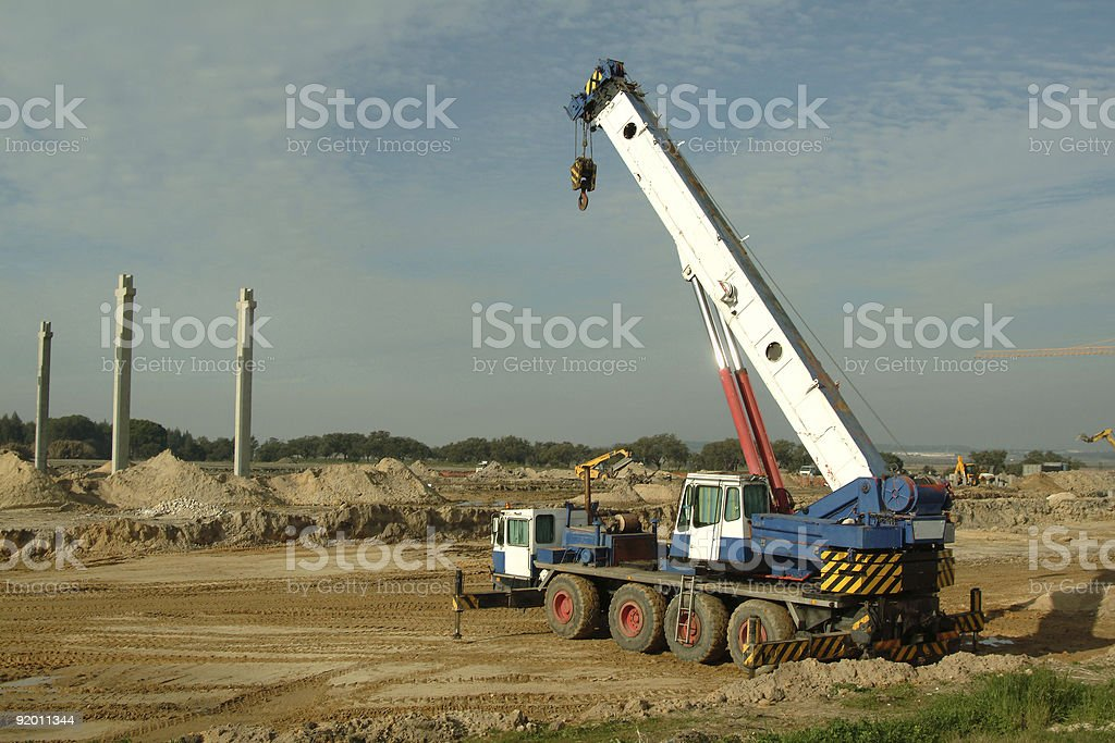large  crane in construction site royalty-free stock photo