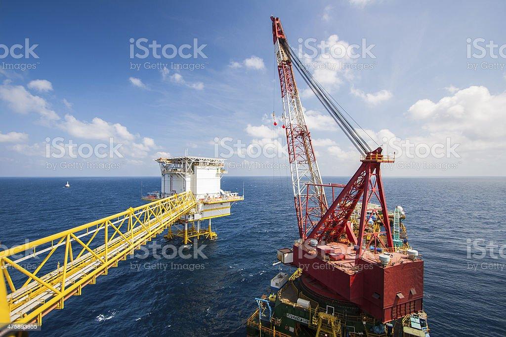 Large crane vessel installing the platform in offshore stock photo