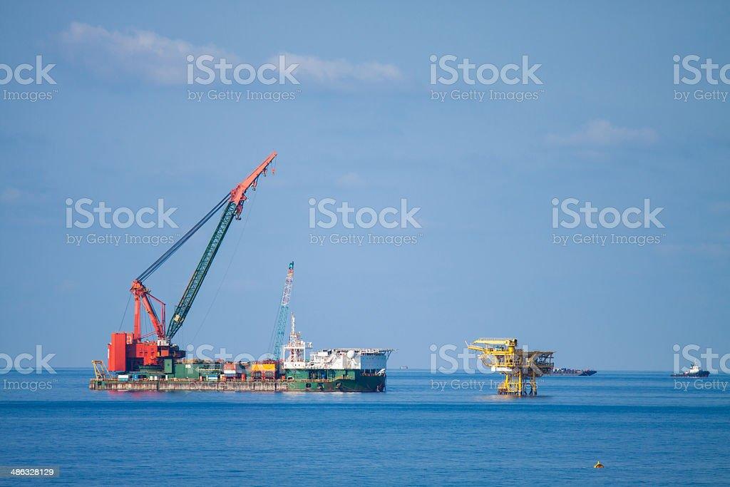 Large crane vessel installing the platform stock photo