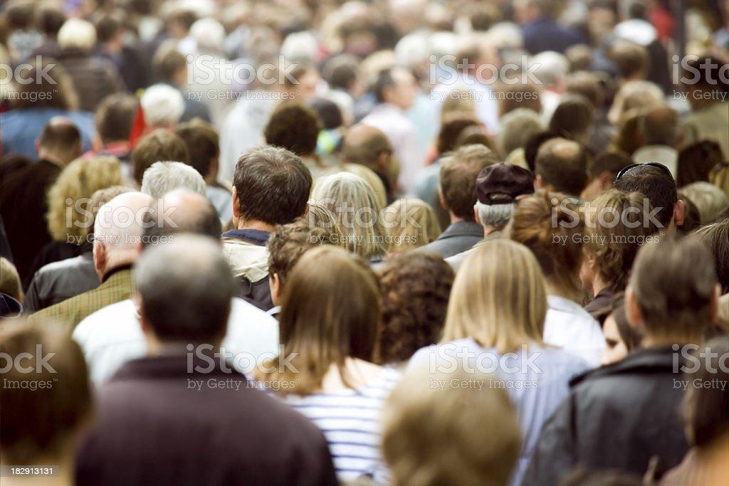 Large crowd of pedestrians walking stock photo