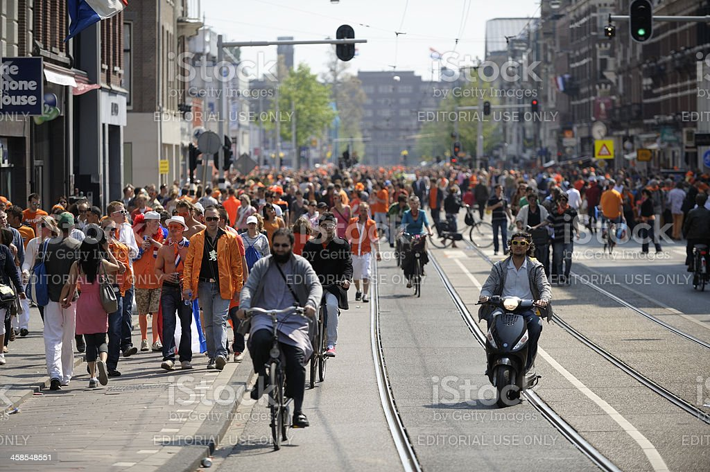 Large crowd of people in Amsterdam on Queen's day royalty-free stock photo