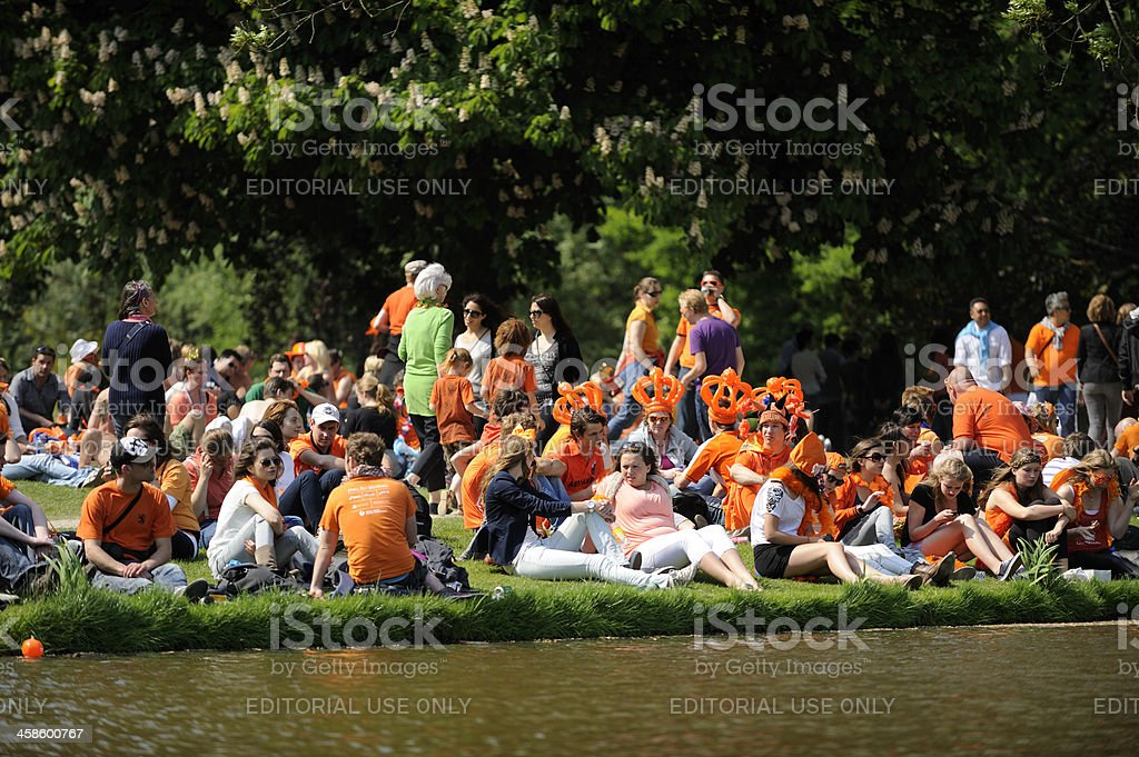Large crowd of people relaxing in Vondelpark Amsterdam royalty-free stock photo