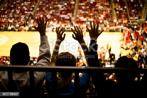 istock Large crowd people attend a sports event. Stadium. Basketball court. 522738337