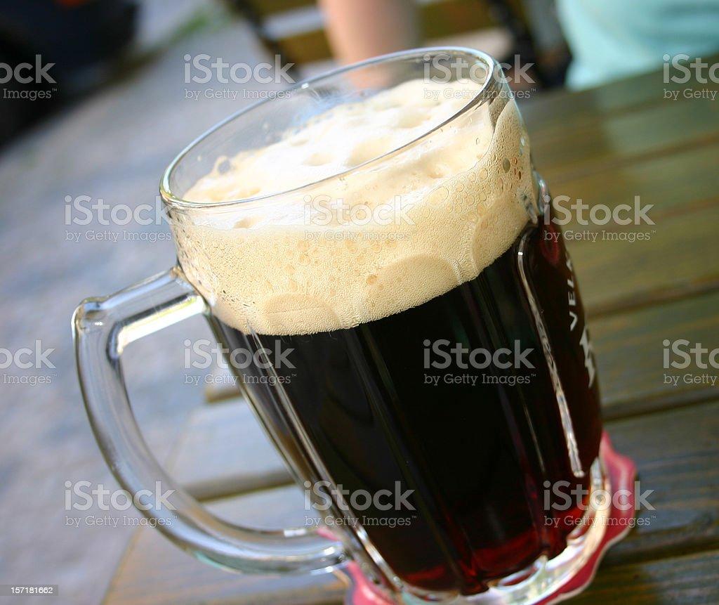 Large Dark Beer glass Prague royalty-free stock photo