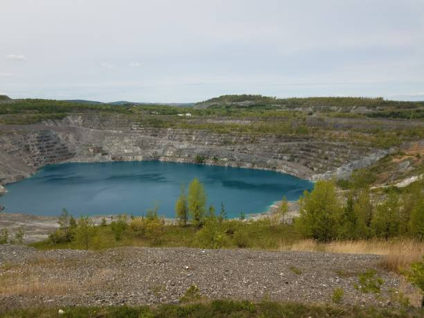 large deep blue lake where asbestos was mined in Canada stock photo