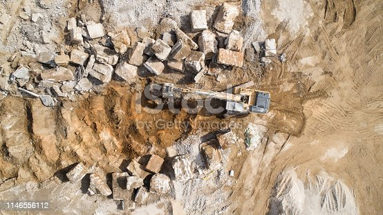 Large demolition area - debris and construction machinery, bulldozer - aerial view