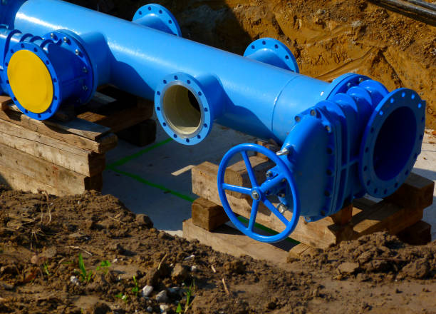 large diameter painted light blue steel water main pipe installation - diameter stock pictures, royalty-free photos & images