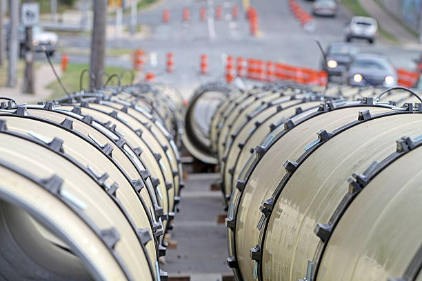 large diameter pipe sections on a water main renewal project - diameter stock pictures, royalty-free photos & images