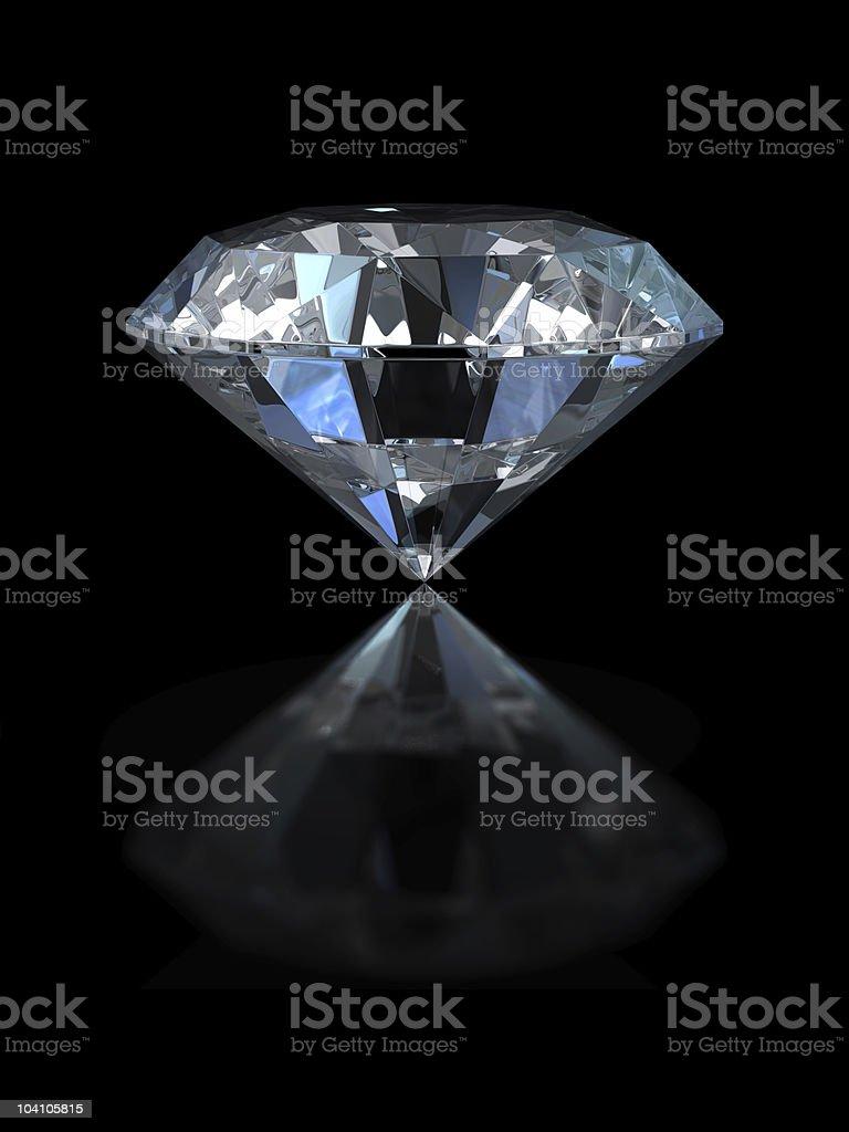 Large diamond with reflection set against black background royalty-free stock photo