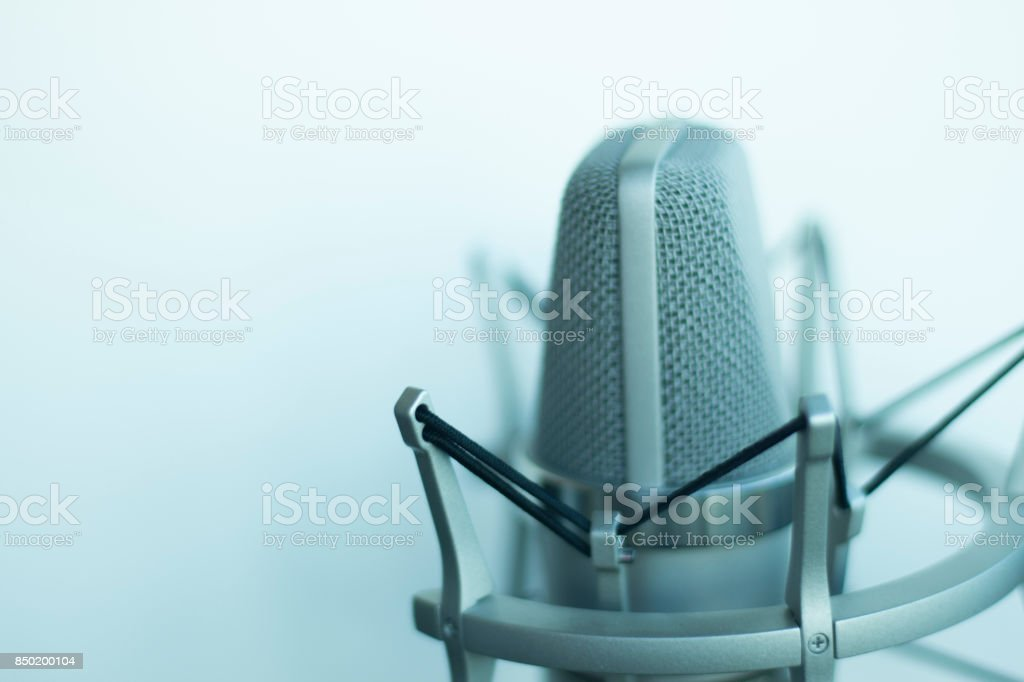 Large diaphragm condenser studio recording voice microphone to record professional voiceovers, singing and dubbing stock photo