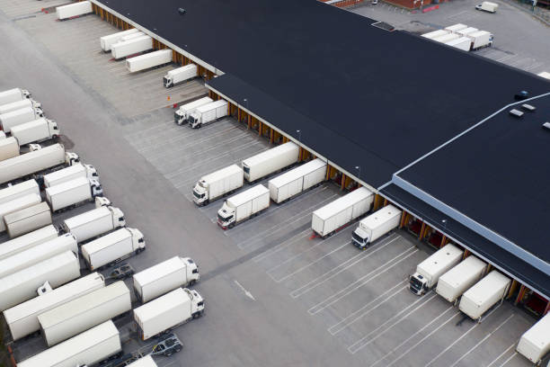 Large distribution center with many trucks viewed from above stock photo