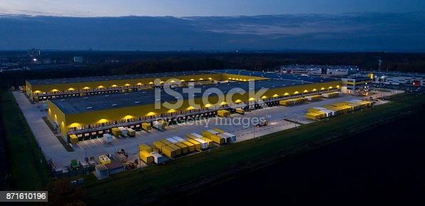 istock Large distribution hub, trucks and trailers 871610196