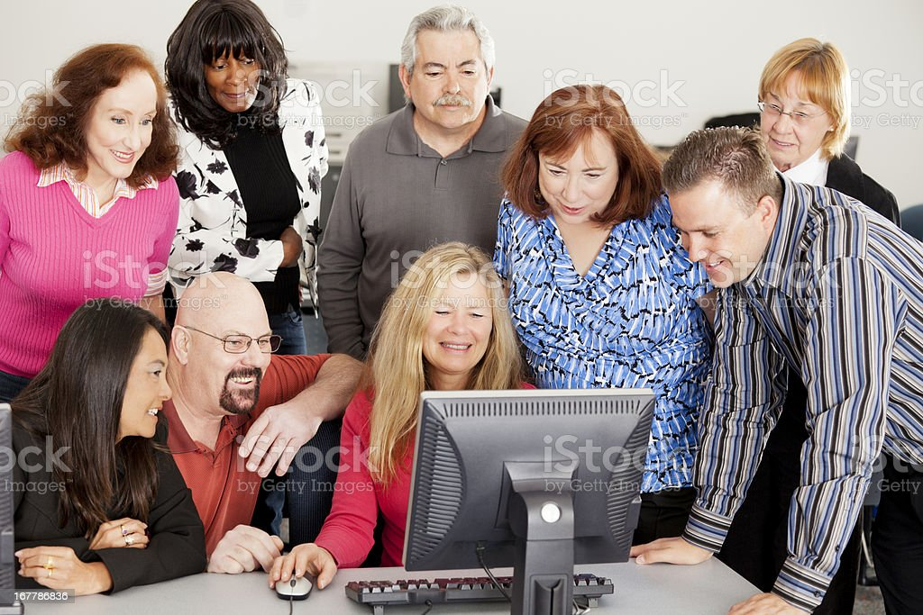 Large diverse group in front of computer royalty-free stock photo