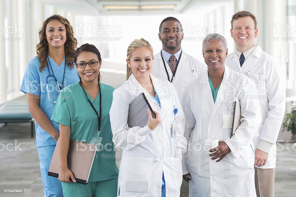 Large diverse group of hospital doctors, surgeons, and nurses stock photo