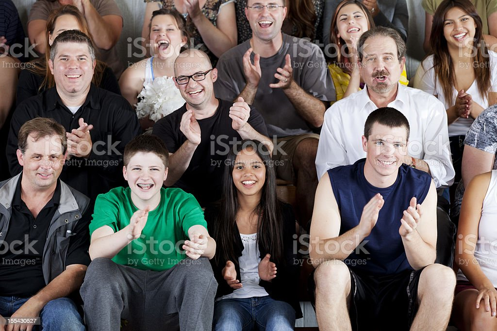 Large diverse group of people watching an exciting game royalty-free stock photo